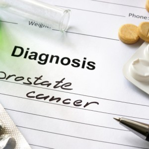 Diagnosis prostate cancer written in the diagnostic form and pills.